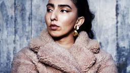 Woman in furry coat and earrings