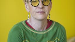 Beate Grimsrud in yellow glasses against a yellow background