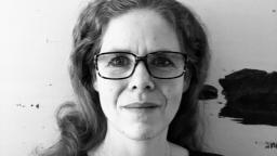 Black and white headshot of Kina Nilsson in glasses