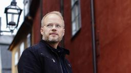 Johan Rundberg in front of red building