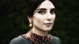 Balsam Karam in necklace and earrings