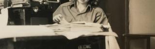 Black and white image of Patricia Crampton reading