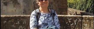 Sarah Death sitting in sunshine smiling