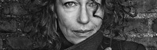 Elisabeth Åsbrink wrapped up in coat