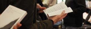 book launch scene - hands holding an open book