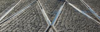 tram rails on cobbled street
